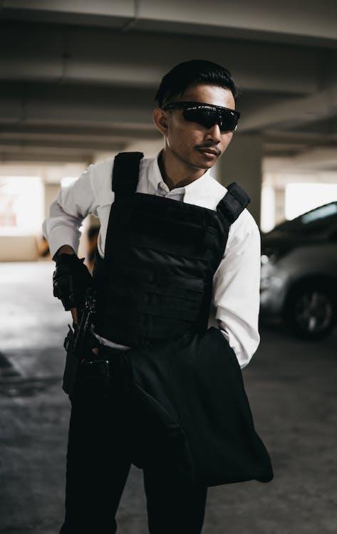 Man in White Dress Shirt and Black Bulletproof Vest