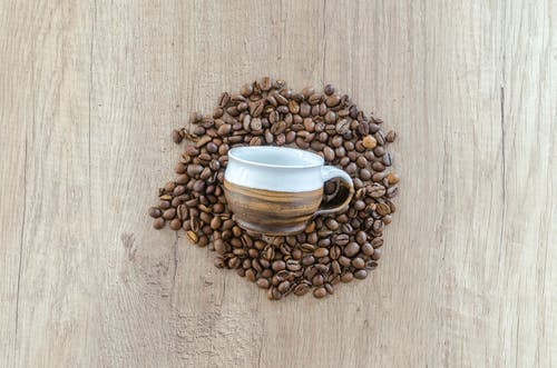 Brown Mug on Brown Coffee Beans