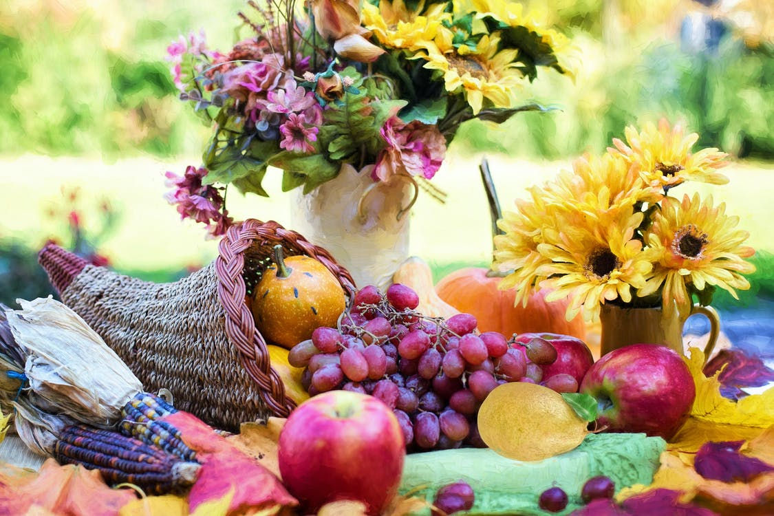 Yellow Sunflower and Red Apple Fruits on Green Table