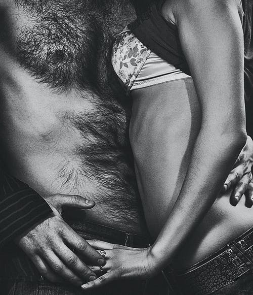Topless Photo of Man and Woman