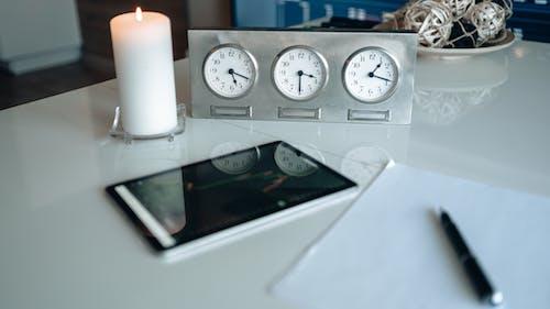 White Analog Clocks on Gray Frame