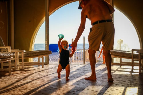 Adult man with toddler on resort