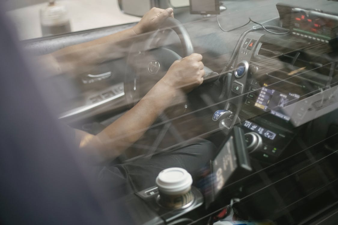 Man driving automobile with convenient dashboard
