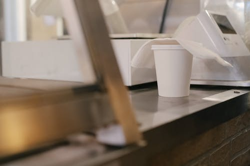 Paper cup of coffee on counter