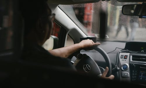 Driver siting in car in rainy weather