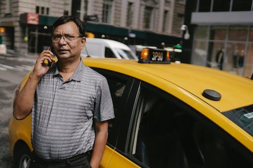 Thoughtful ethnic man talking on phone
