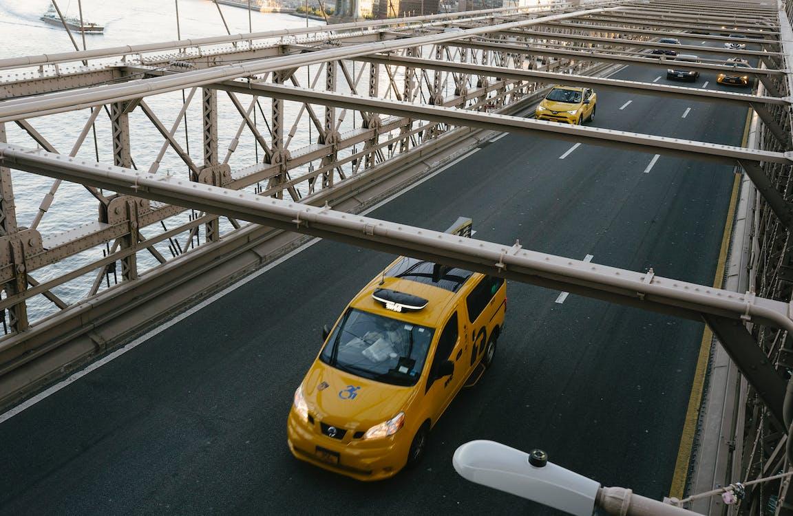 Taxi cabs driving on suspension bridge