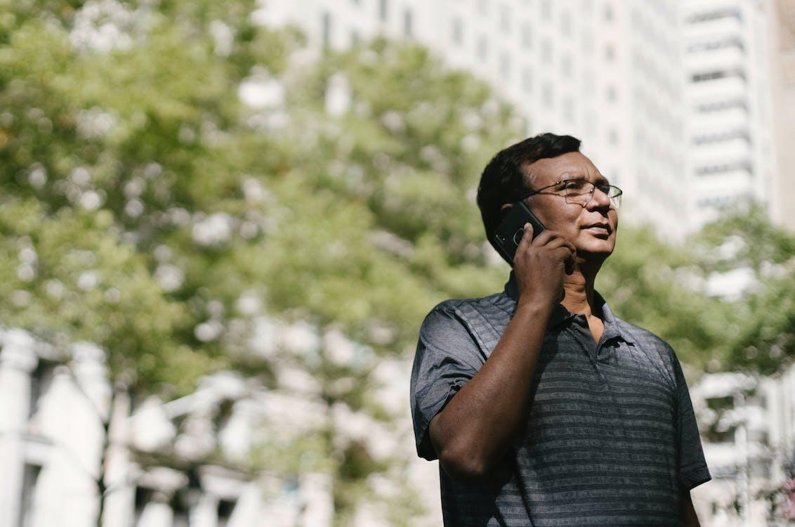 Ethnic man having conversation on phone