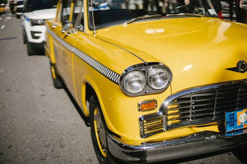 Parked retro cab on asphalt road