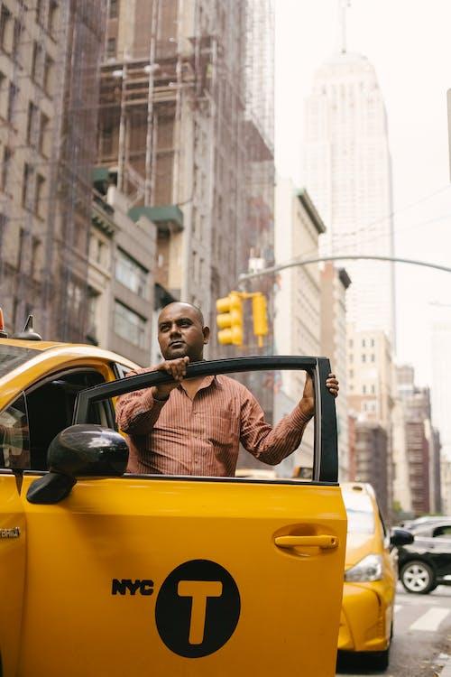 Man standing near opened door of cab