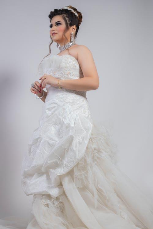 Gorgeous woman in white gown for wedding celebration
