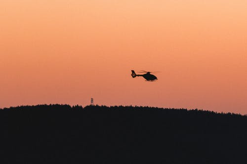 Free stock photo of black and orange, helicopter, shadow
