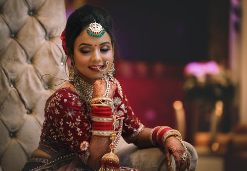 Girl in Red and Gold Traditional Dress
