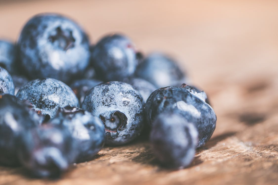Selective Focus Photography of Bunch of Blueberries