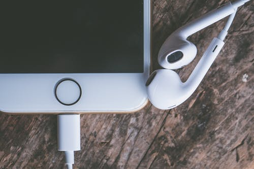 Closeup Photography of Iphone and Earpods