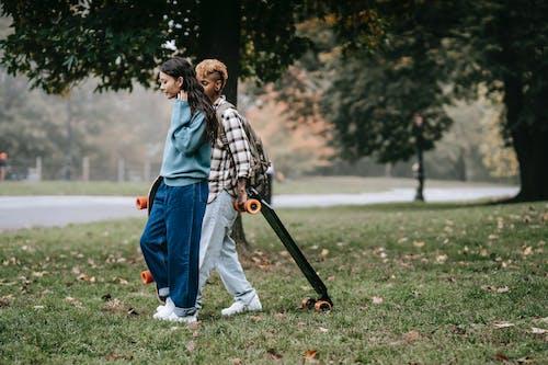 Diverse friends walking in park