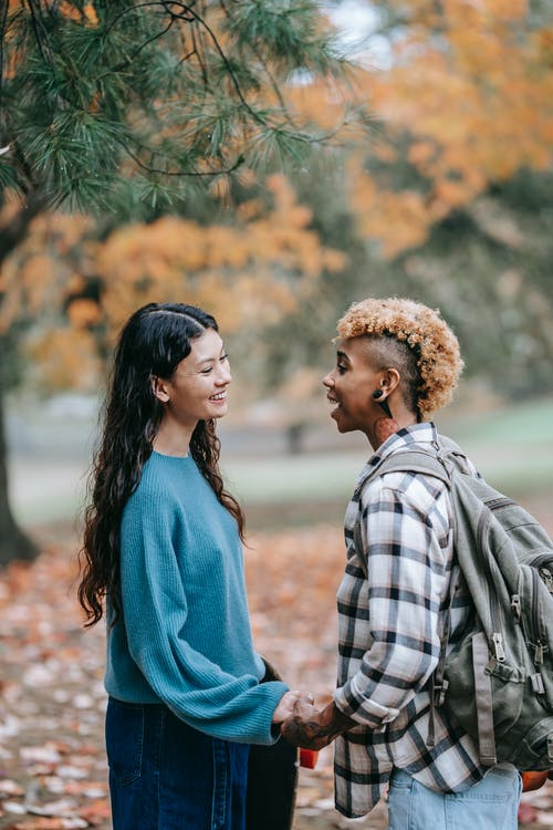 Laughing couple in autumn park