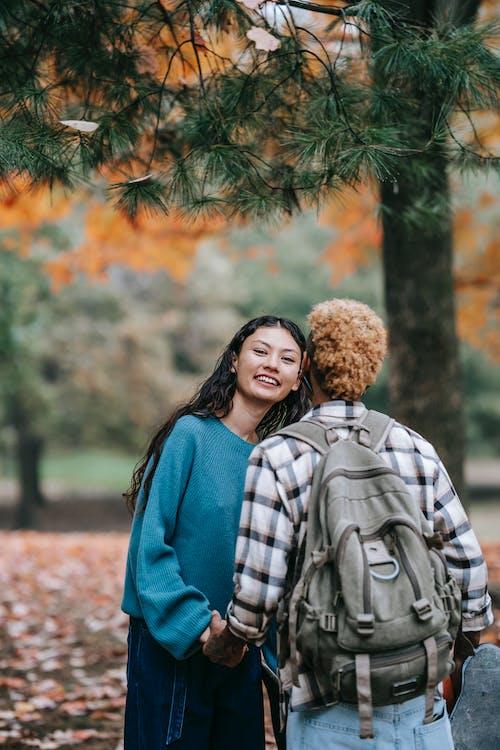 Cheerful multiethnic couple in park
