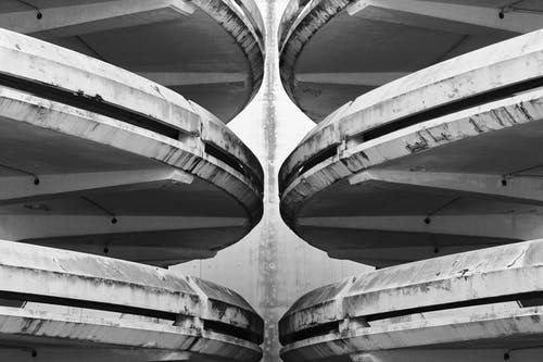 Grayscale Photo of Tunnel With Tunnel
