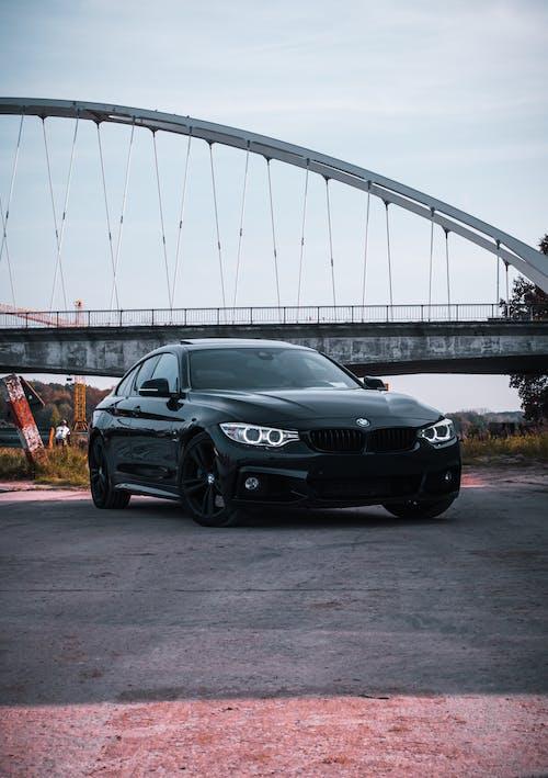 Black Mercedes Benz Coupe Parked Near Bridge