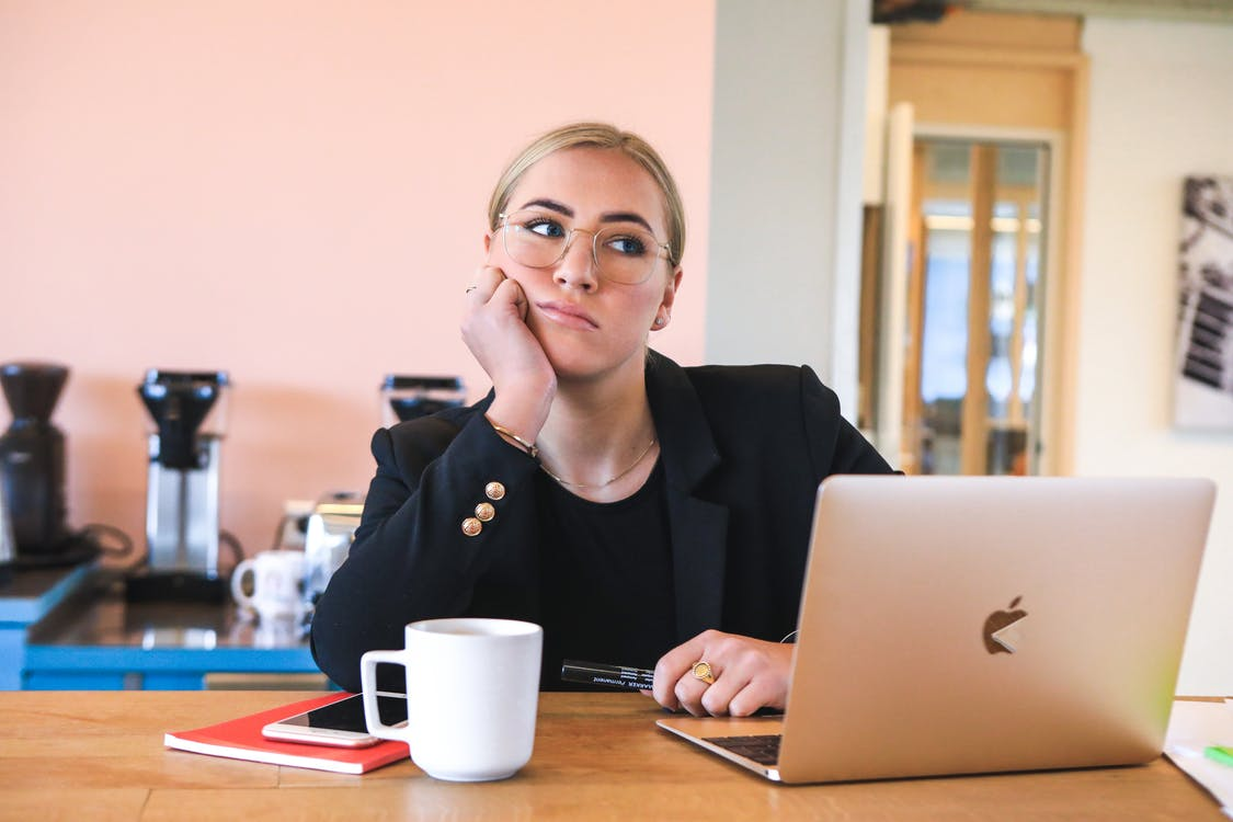 Woman in Black Crew Neck Shirt Using Macbook