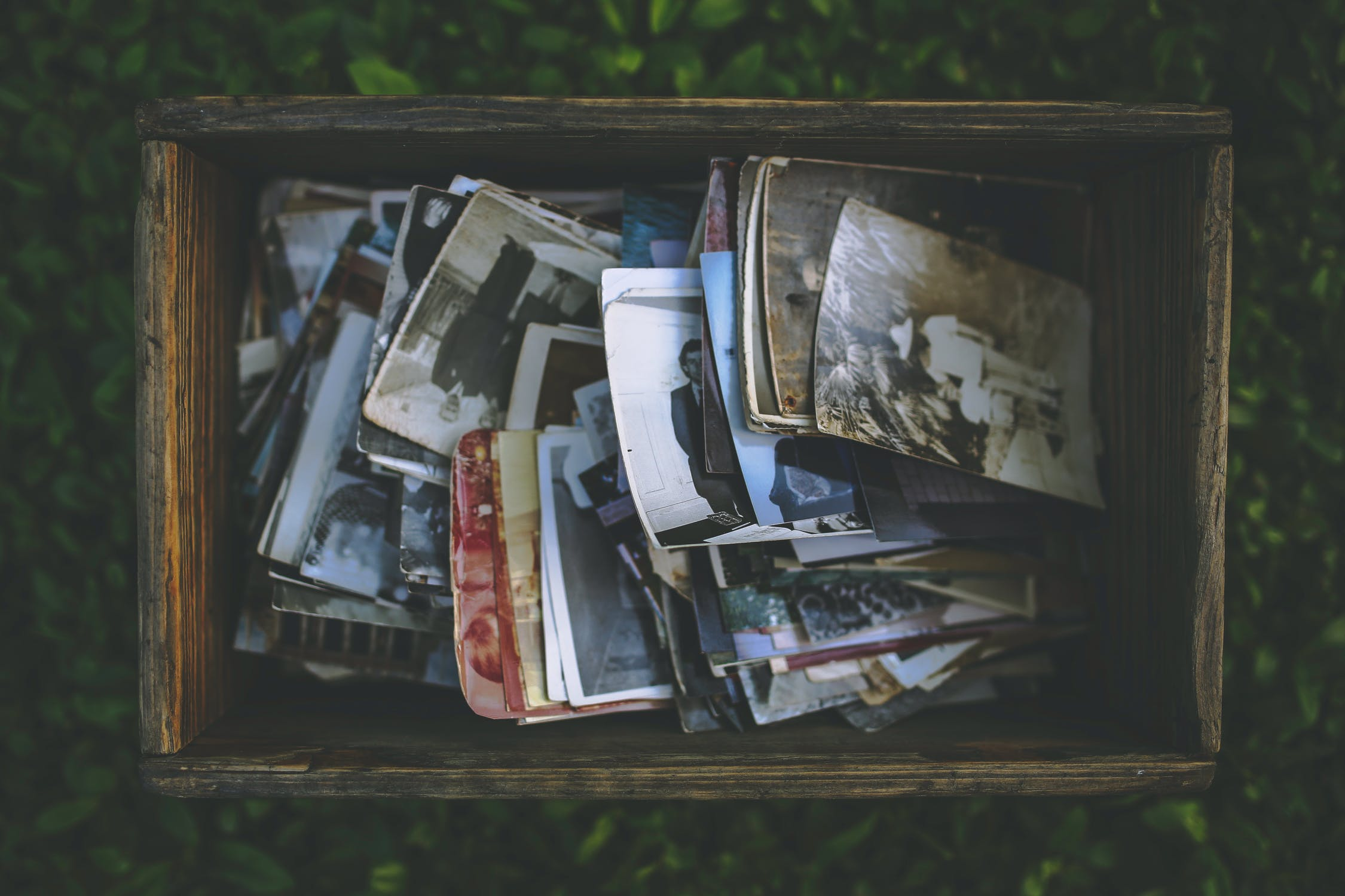 A box of old photos, that are not used very often and can be put in storage.