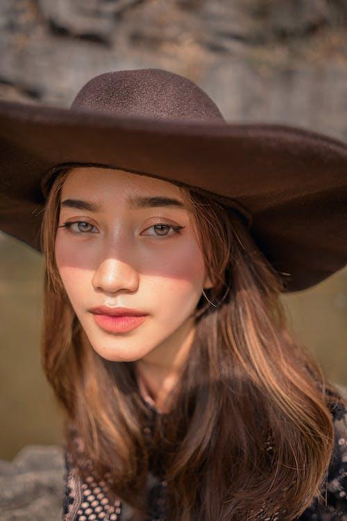 Woman in Black Cowboy Hat