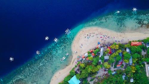 Foto profissional grátis de aéreo, água, antena, areia
