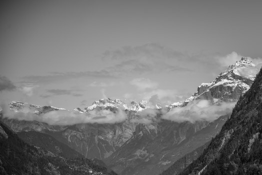 Snow Covered Rugged Mountain With Mist Photograph