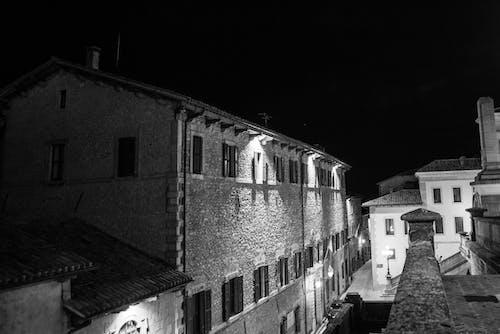 Monochrome Photo of Concrete Houses