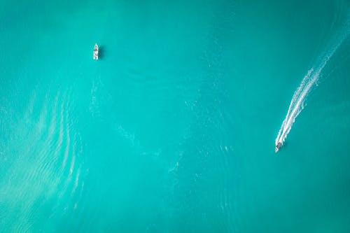 Aerial azure sea with floating boats