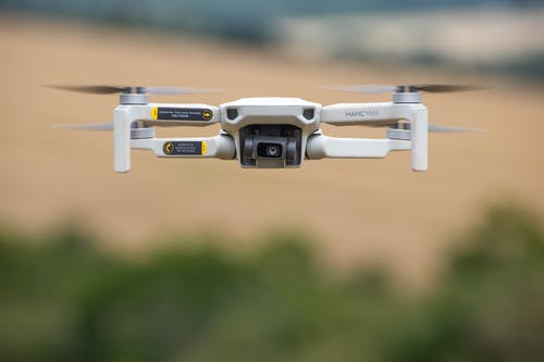 White and Black Drone in Close Up Photography