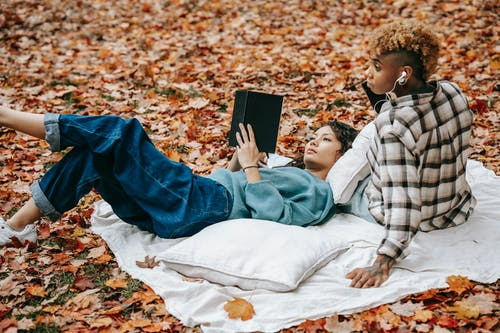 Multiracial loved women resting in park