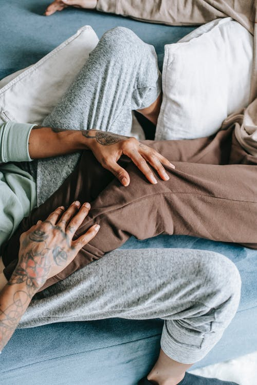 Couple in home clothes resting on bed