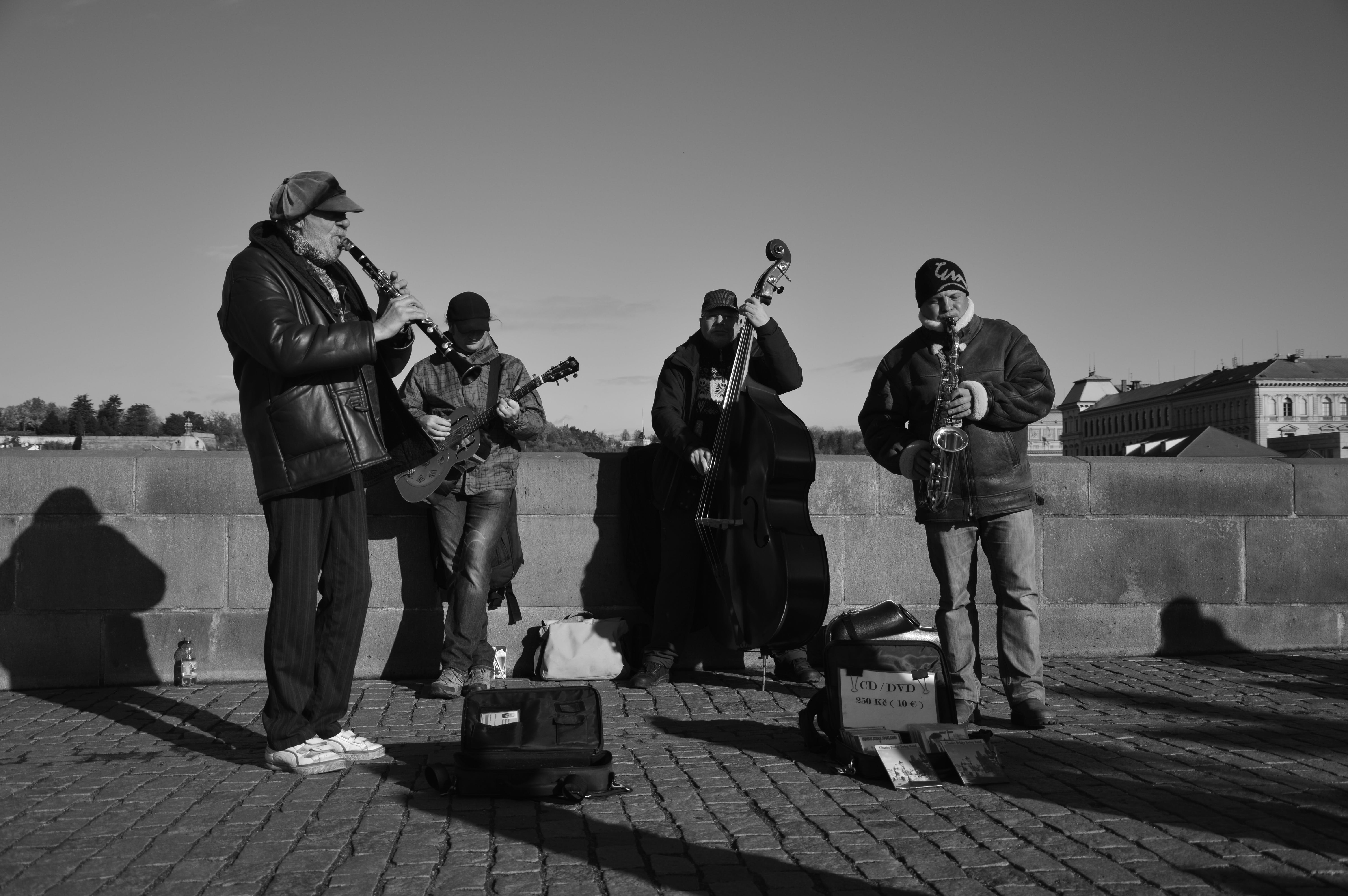 Grayscale Photo of People Playing Instruments