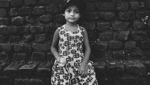 Grayscale Photo of Girl in Dress