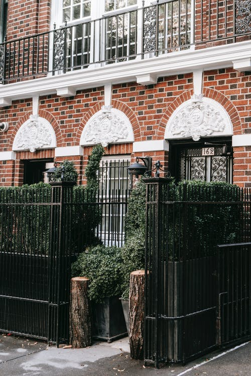 Exterior of residential building with metal fence