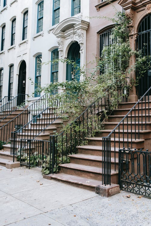 Entrances of classic buildings with stairs