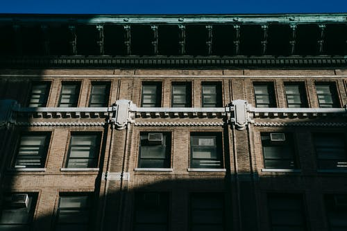 Facade of residential building with cornice