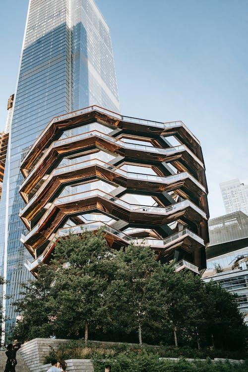 Modern futuristic building above trees