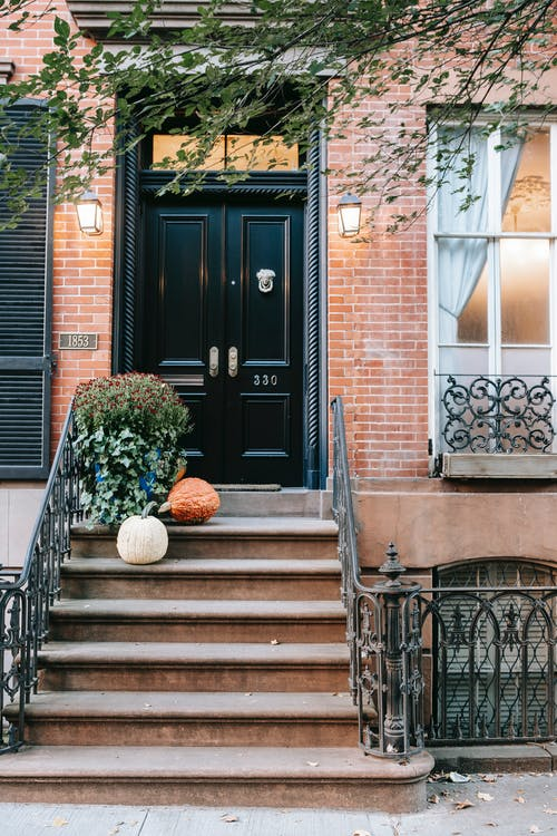 Entrance with pumpkins on stone stairs