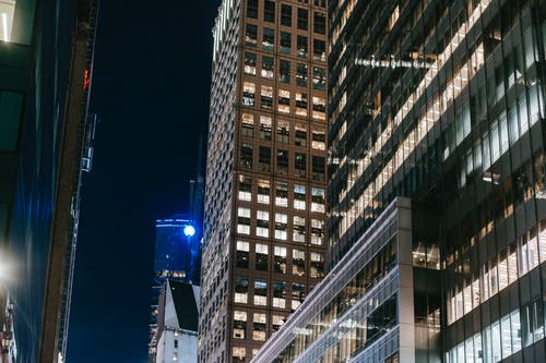 Modern skyscrapers with glass walls and bright lights