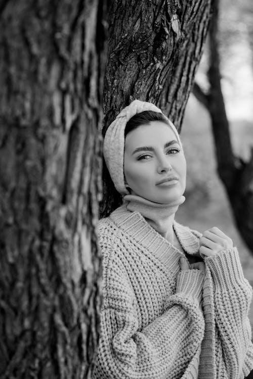 Grayscale Photo of Woman Wearing Knit Sweater