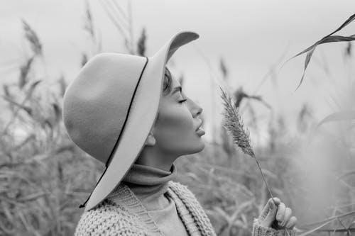 Grayscale Photo of Girl Wearing Hat