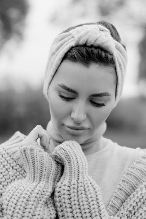 Grayscale Photo of Smiling Girl Wearing Knit Cap