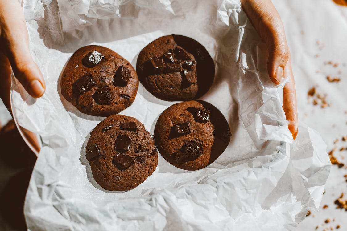 Chocolate Cookies on White Plastic Pack