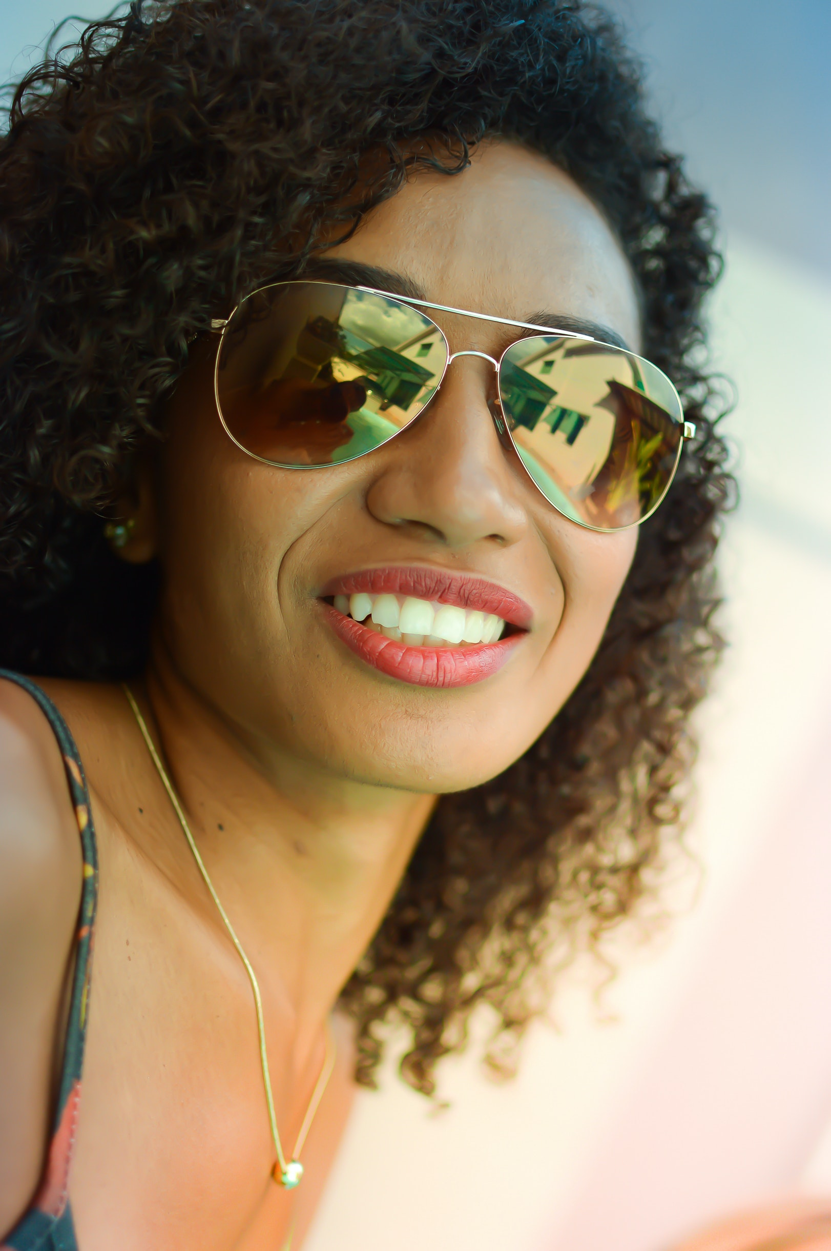 Girl In Black Framed Sunglasses With Color On Her Face