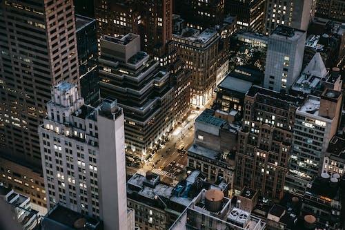 Modern illuminated city district in evening