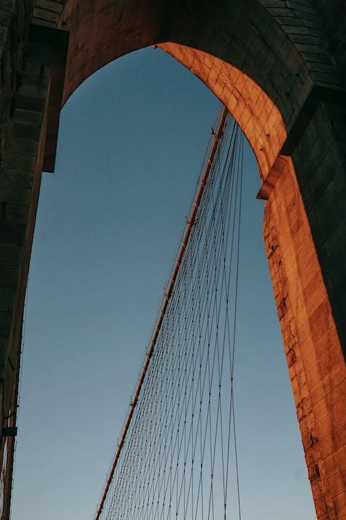 Brick arch on bridge under sunlight
