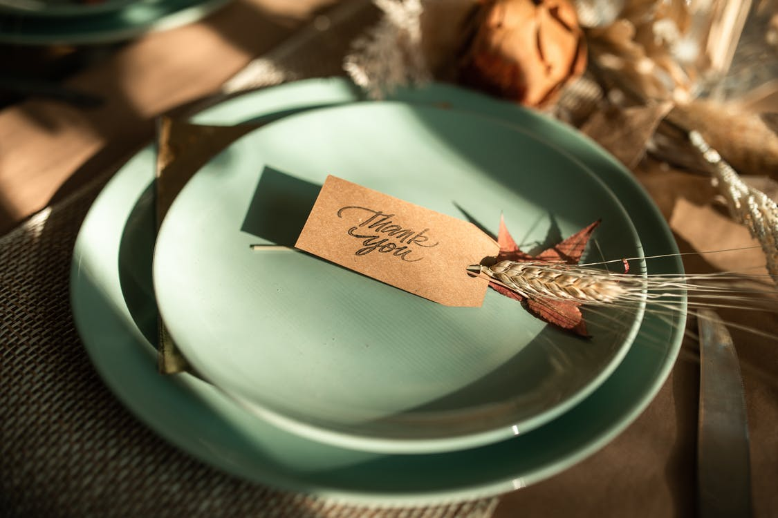 White and Brown Card on Green Ceramic Round Plate